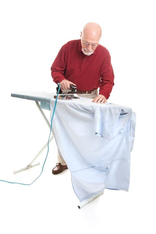 Download Senior Man Irons His Shirt stock photo. Image of household - 34653728