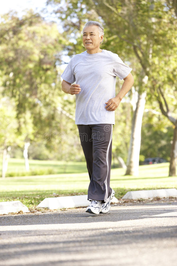 Senior Man Jogging In Park stock photography