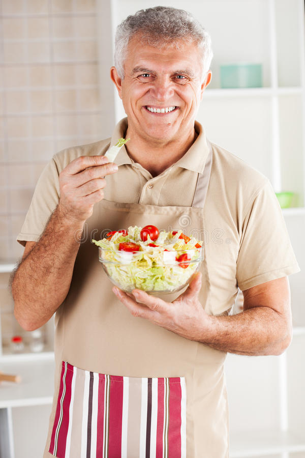 Senior man in the kitchen royalty free stock image