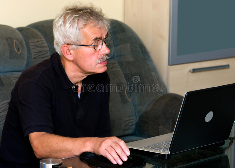 Senior man and laptop stock photo