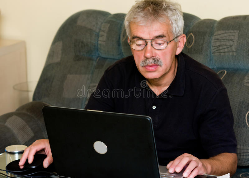 Senior man and laptop royalty free stock photo