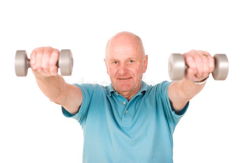 Download Senior man lifting weights stock image. Image of older - 12033657