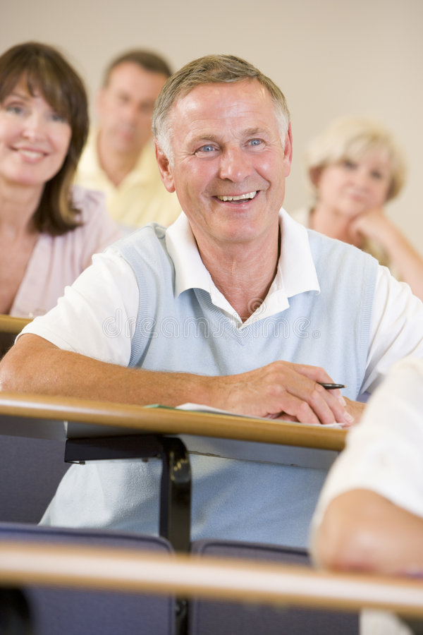 Senior man listening to a university lecture royalty free stock photo