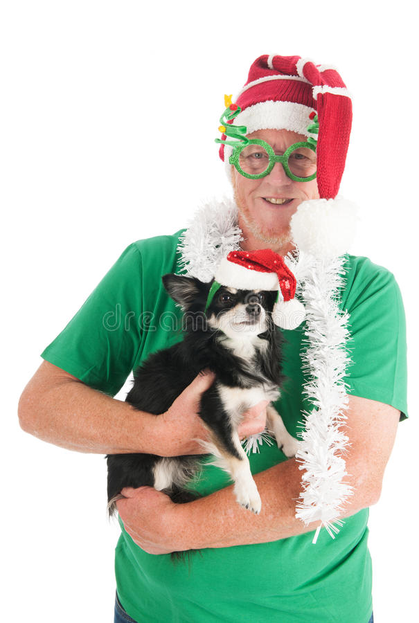 Senior man with little dog for Christmas. Senior man with funny glasses and little dog for Christmas royalty free stock photo