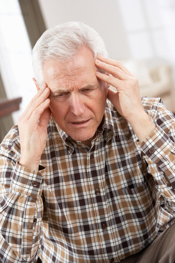 Senior Man Looking Stressed In Chair Royalty Free Stock Photo