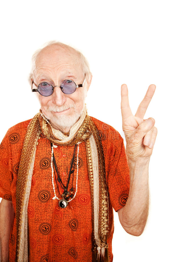 Senior Man Making Peace Sign. New age senior man in orange shirt making peace sign royalty free stock photography