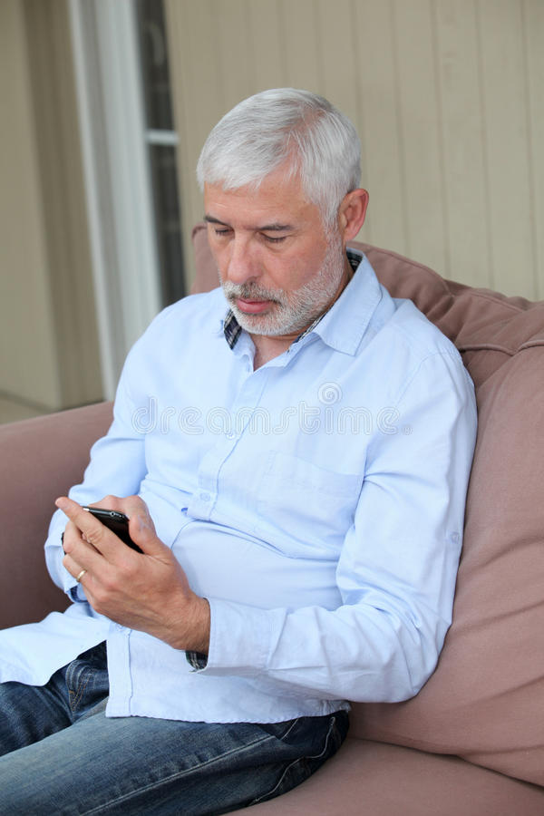 Download Senior man and mobilephone stock image. Image of portrait - 19294217