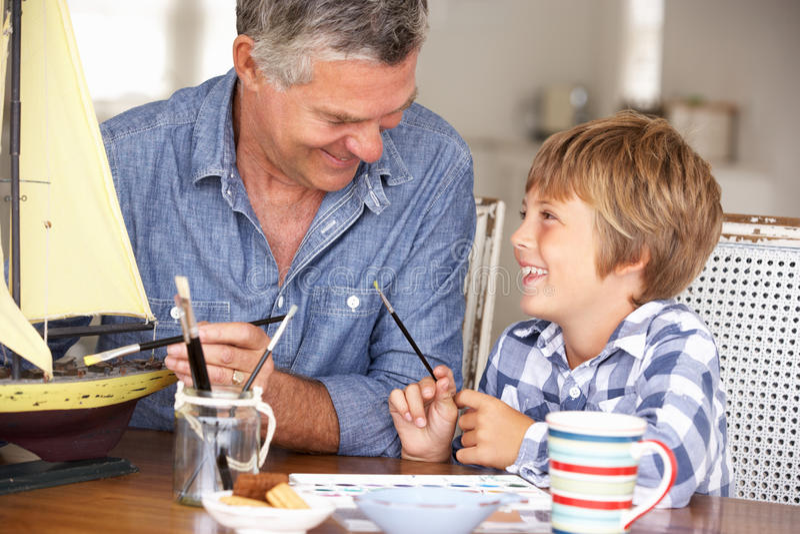 Senior Man Model Making With Grandson Stock Image