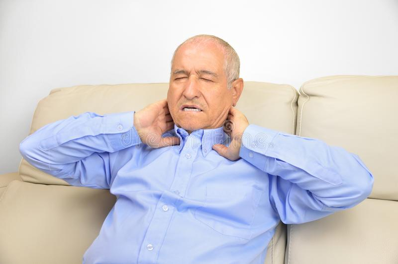 Senior man with neck pain royalty free stock photography