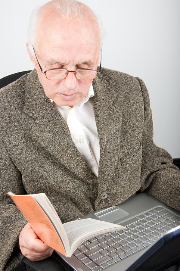 Download Senior Man With Notebook Learning Computer Stock Photo - Image: 12866512