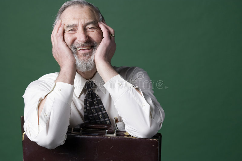 Senior man with old briefcase stock image