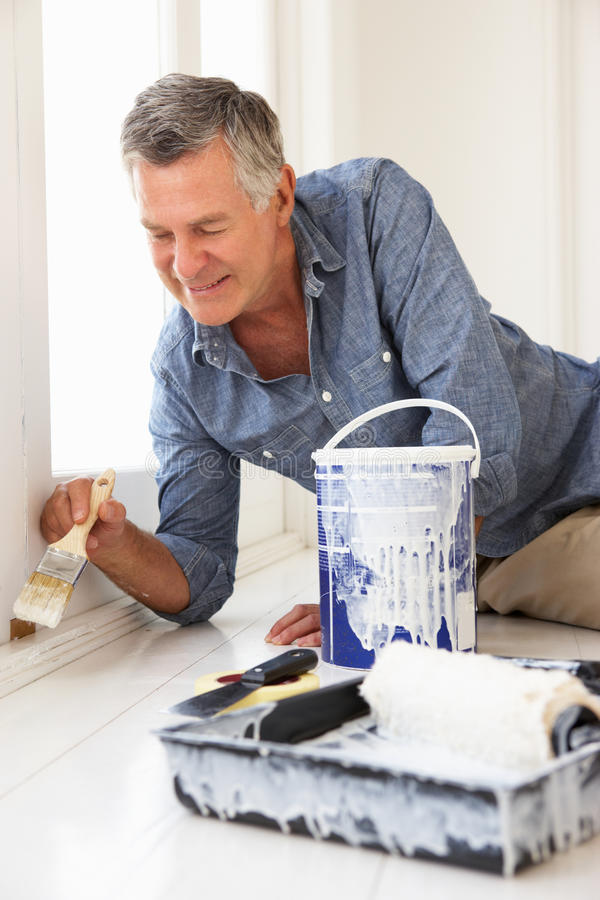 Senior man painting house