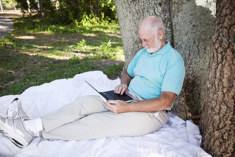 Senior Man in Park With Computer royalty free stock photography