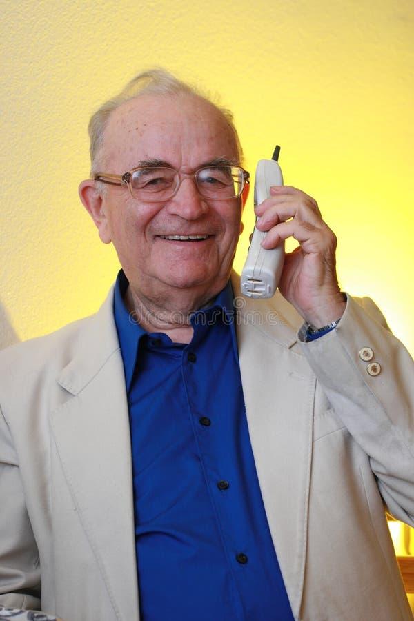 Senior man on the phone stock photography