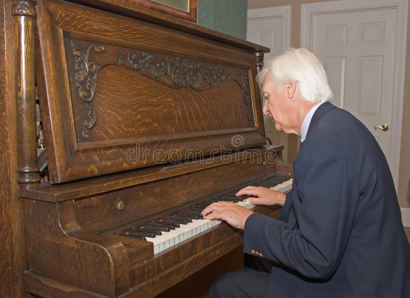 Download Senior Man Playing Piano stock photo. Image of back, working - 1549328