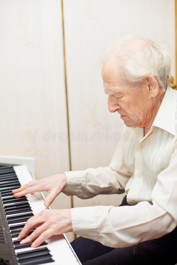 Senior Man Playing Piano stock photos