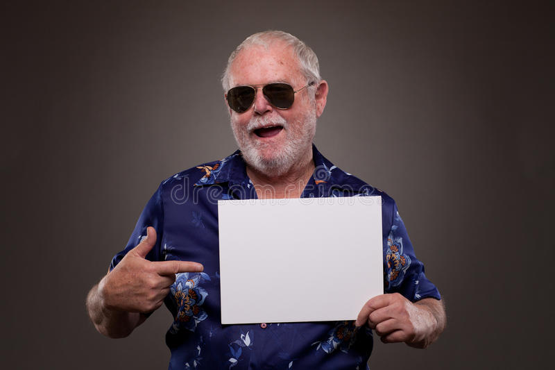 Download Senior Man Pointing At A Placard Stock Photo - Image: 30326884