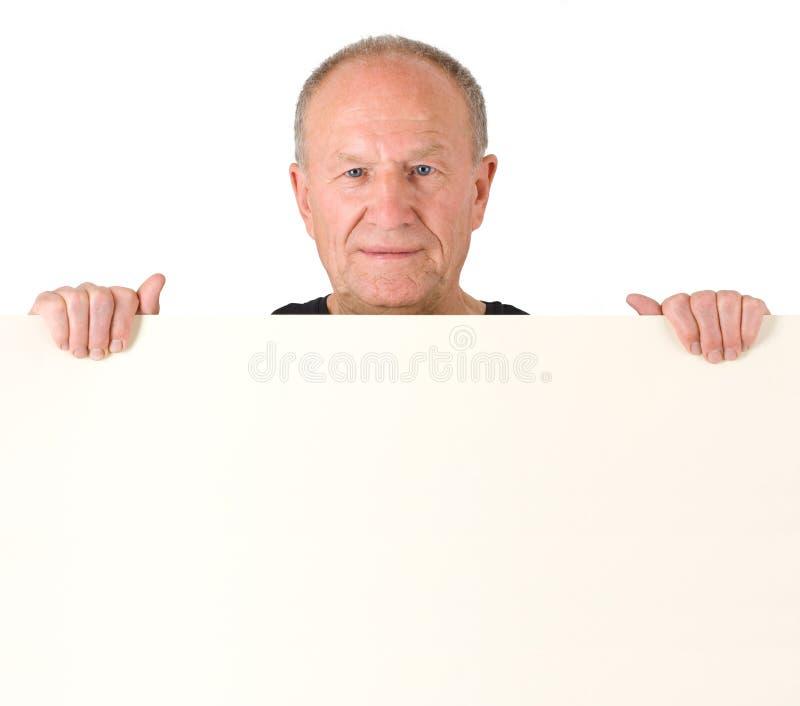 Senior man. Poster. Senior man holding blank poster royalty free stock photography
