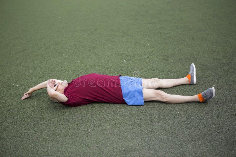 Senior man exercising in an open stadium royalty free stock image