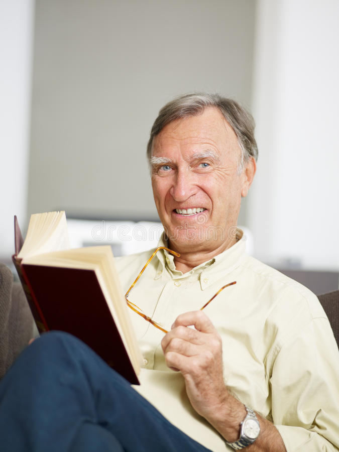 Download Senior man reading book stock photo. Image of relaxation - 11230432