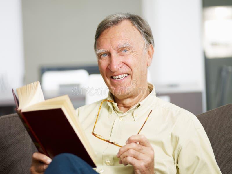 Senior man reading book royalty free stock photos