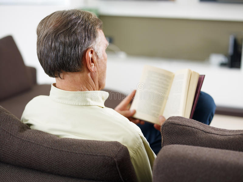 Senior Man Reading Book Stock Photography