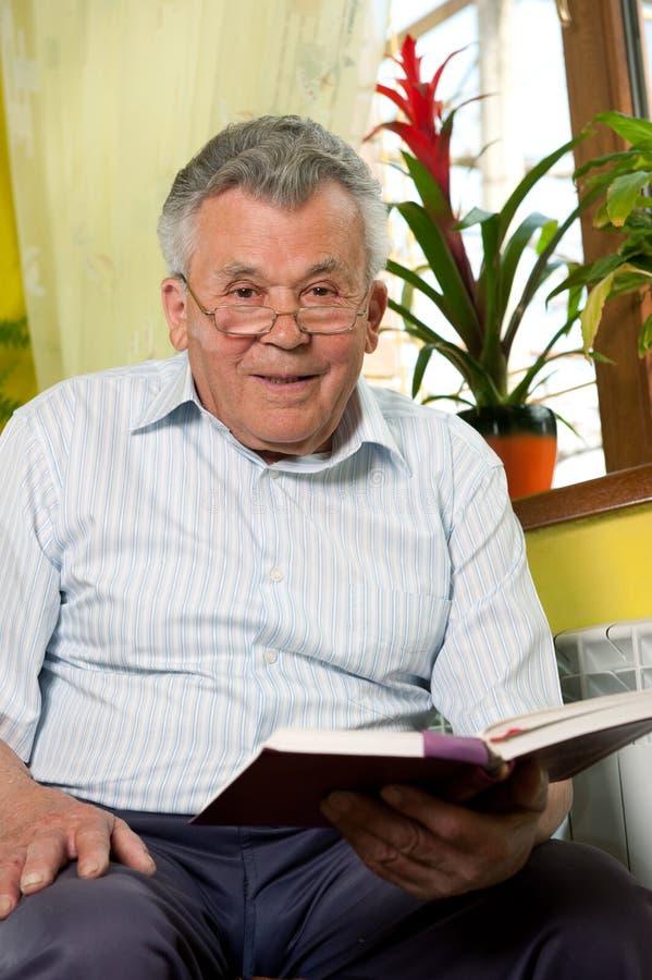 Senior man reading book royalty free stock images