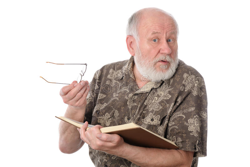 Senior man reading a book, isolated on white stock photo