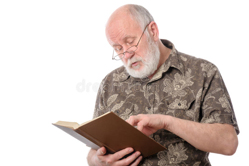Senior man reading a book, isolated on white. Handsome bald and bearded senior man in yeyeglasses reading a book, isolated on white background stock images