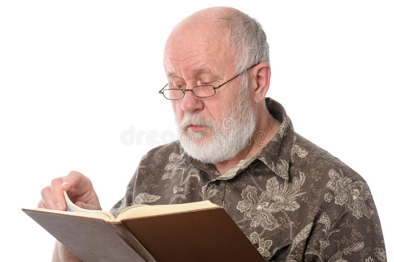 Senior man reading a book, isolated on white stock photography
