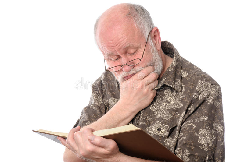 Senior man reading a book, isolated on white royalty free stock images