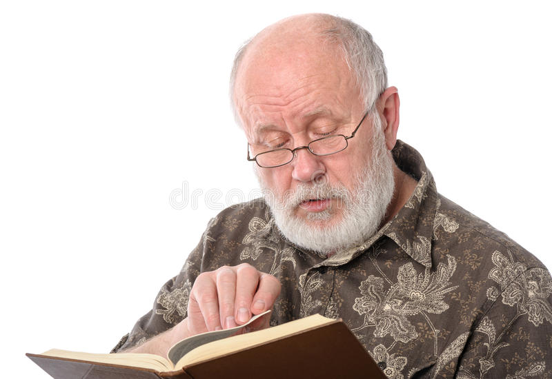 Senior man reading a book, isolated on white royalty free stock photography