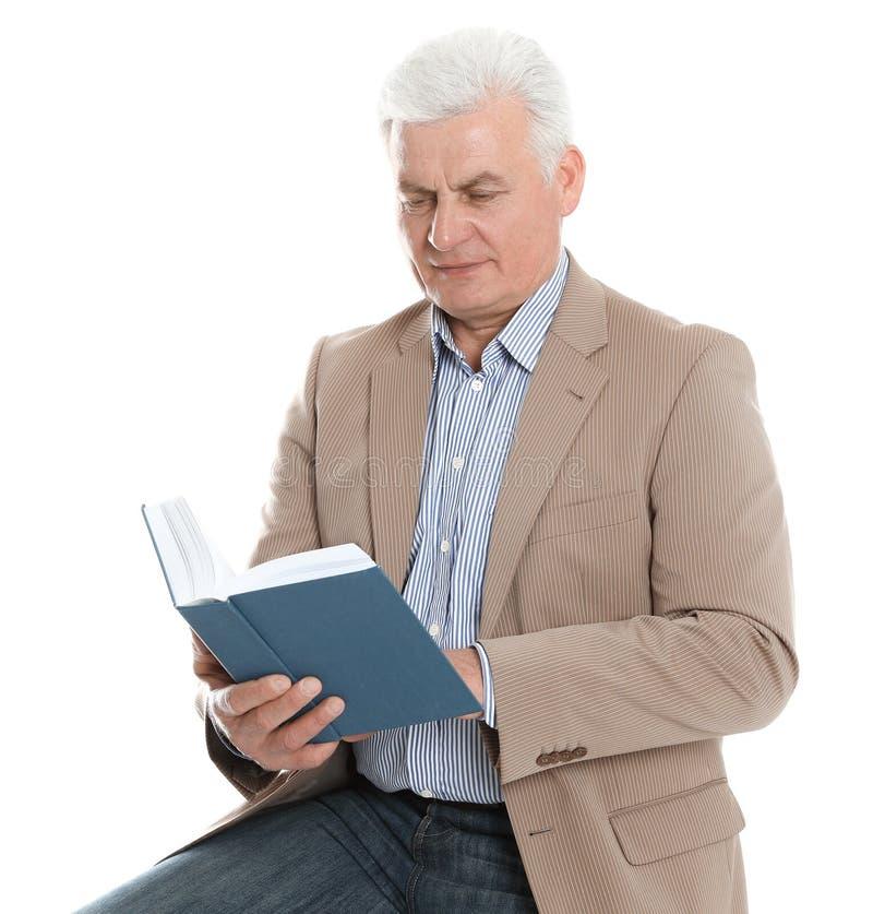 Senior man reading book on white stock photo