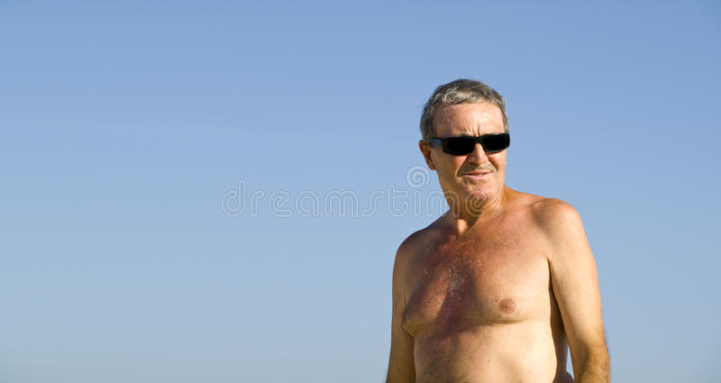 Senior Man relaxing in the beach. Es of Fuerteventura, Spain royalty free stock images