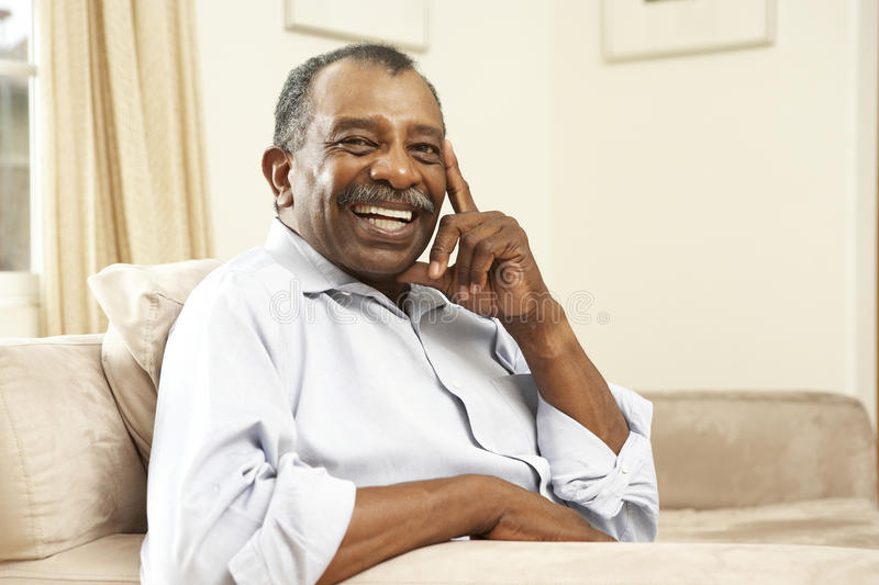 Download Senior Man Relaxing In Chair At Home Stock Photo - Image: 11502214