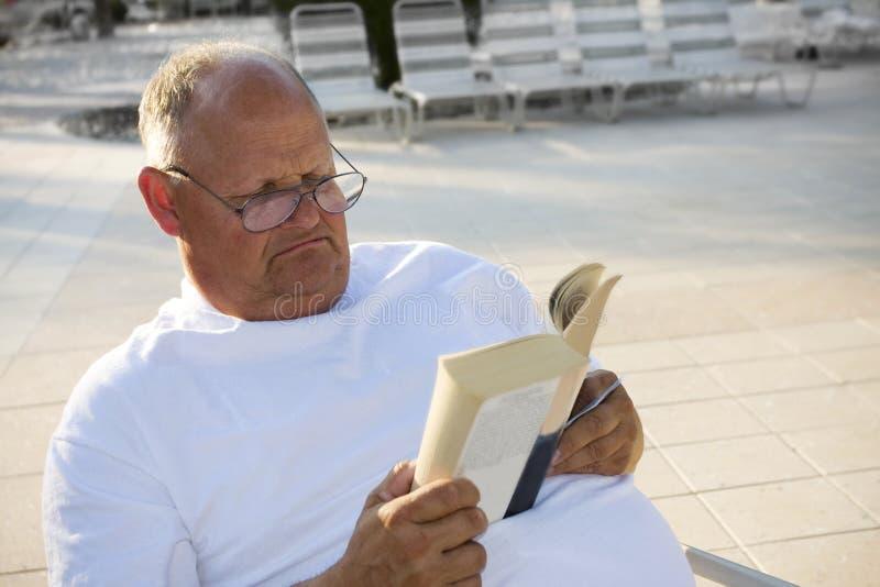 Senior Man Relaxing & Reading Stock Photography