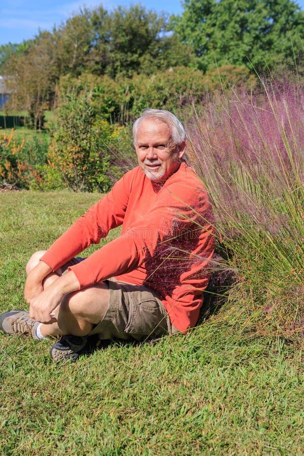 Senior Man Resting in Outdoor Garden royalty free stock photography