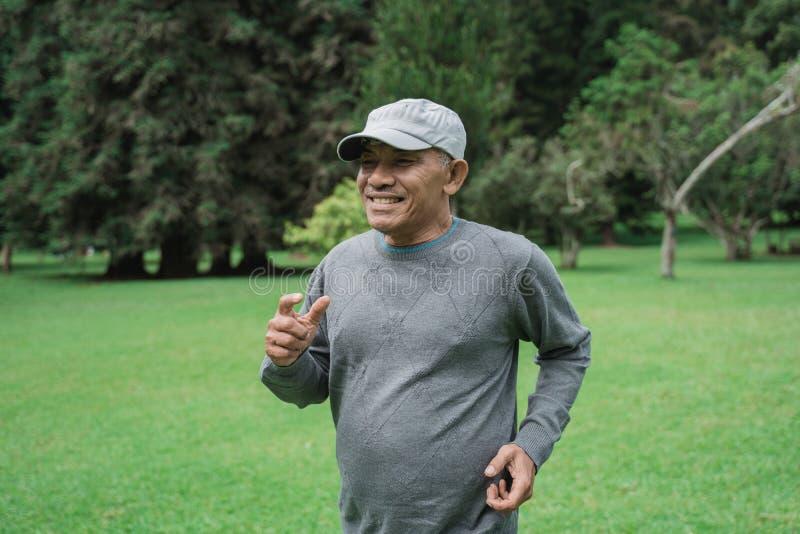 Senior man running in the garden stock photo