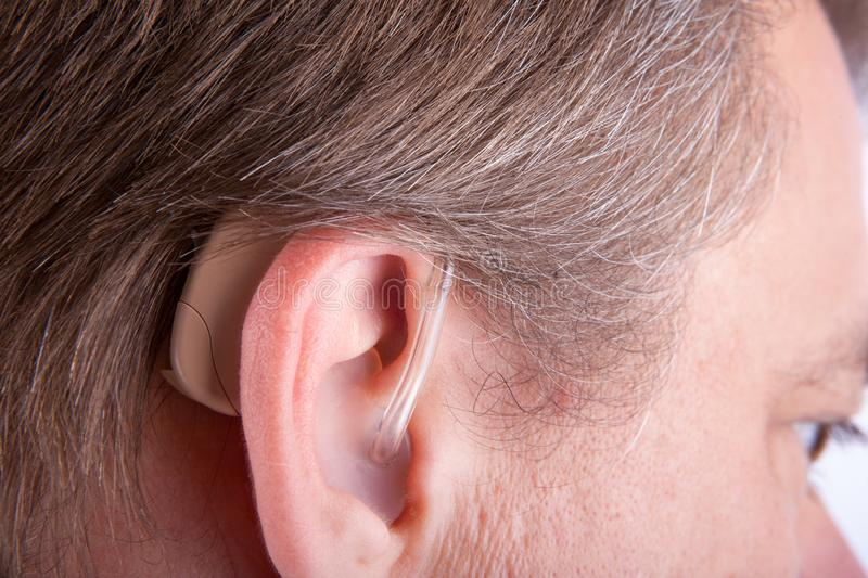 Senior man`s ear wearing hearing aid royalty free stock images