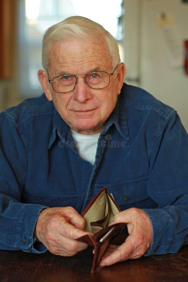 Senior man's empty wallet royalty free stock image
