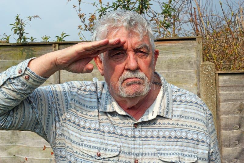 Senior man saluting. royalty free stock image