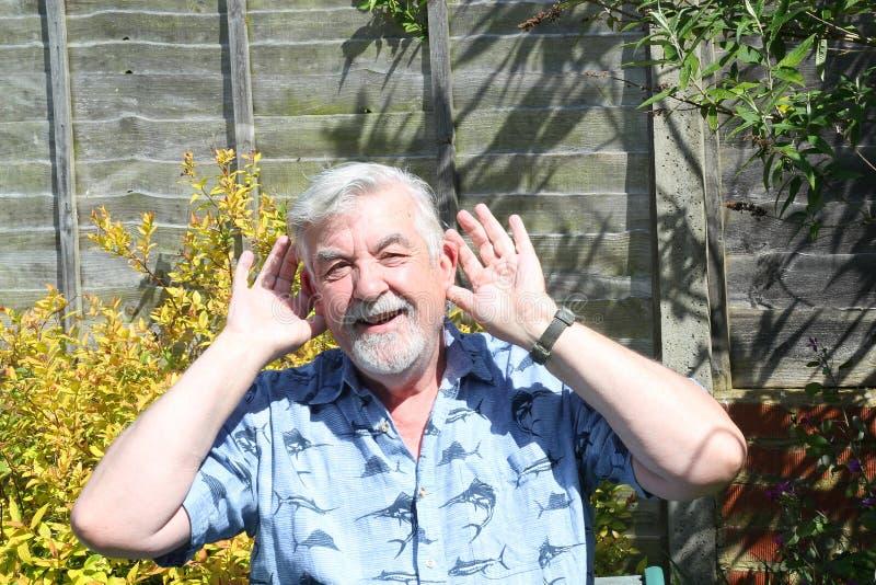 Senior man saying he can not hear. royalty free stock photo
