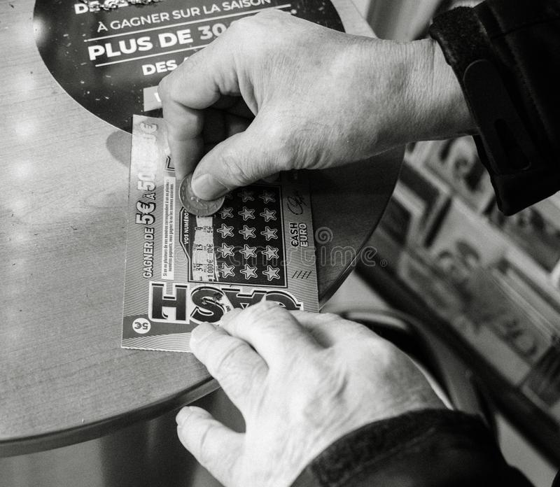 Senior man scratching lottery ticket winning prize cash royalty free stock photography