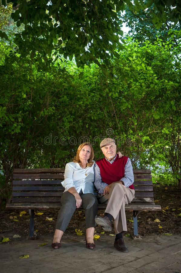Senior man and senior woman doing a self-portrait royalty free stock images