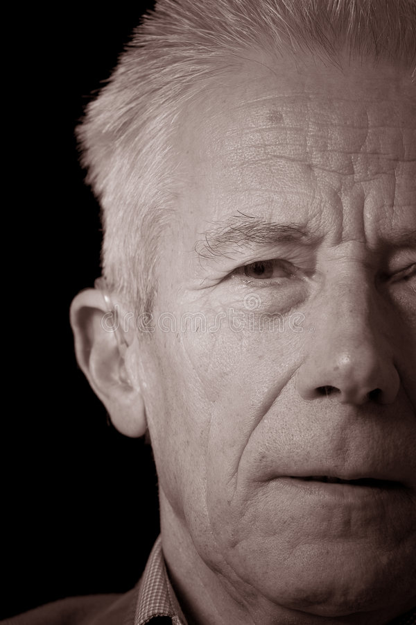 Senior man in sepia portrait royalty free stock image