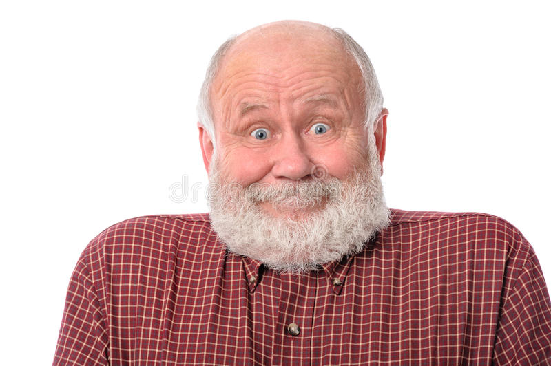 Senior man shows surprised smile facial expression, isolated on white. Handsome bald and bearded senior man shows surprised smile grimace or facial expression royalty free stock images