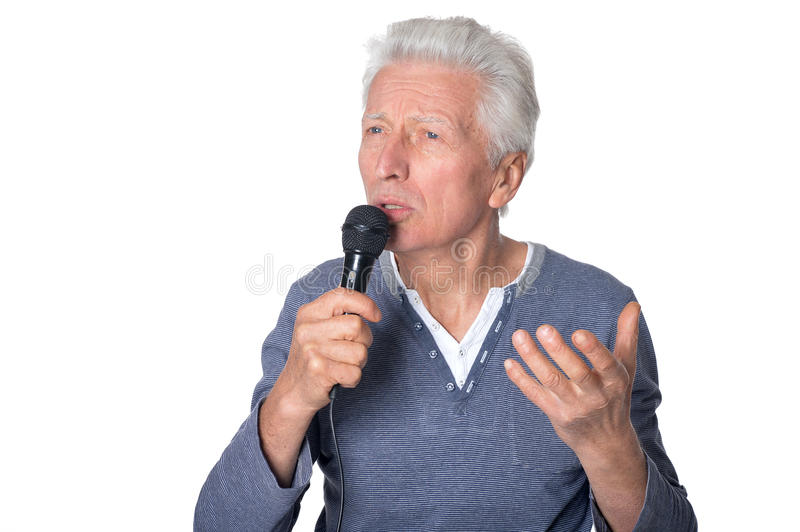 Senior man singing songs. Portrait of a senior man singing songs, against white royalty free stock photos