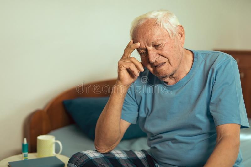Senior man suffering from depression royalty free stock photography