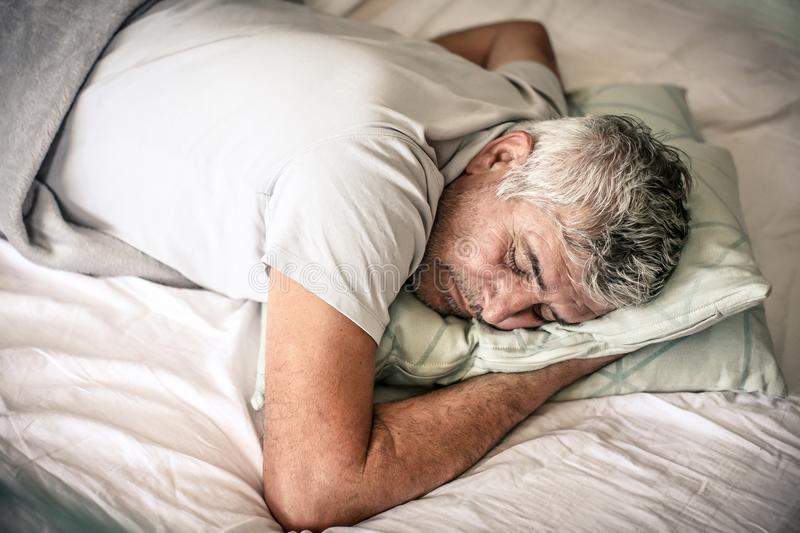 Sleepy senior man. royalty free stock photo