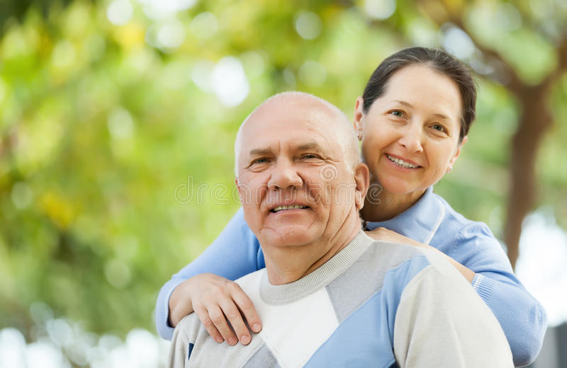 Senior man and smiling mature woman stock photo